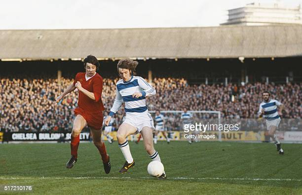 QPR player Stan Bowles fends off a challenge from Alan Hansen of Liverpool during a League Division One match between Queens Park Rangers and...