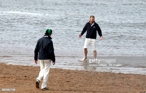 A player stands on the boundary during the beach cricket match in Elie between the Ship Inn cricket team in Elie Fife and Eccentric Flamingos CC as...