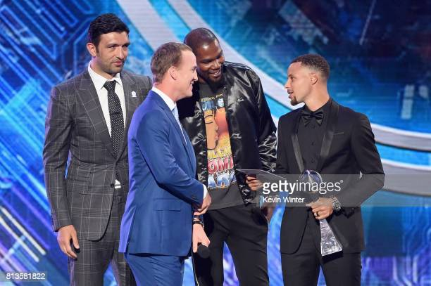 NBA player Steph Curry accepts the Best Team award on behalf of the NBA champion Golden State Warriors from host Peyton Manning with teammates Zaza...