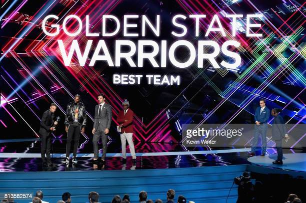 NBA player Steph Curry accepts the Best Team award on behalf of the NBA champion Golden State Warriors with host Peyton Manning actor Samuel L...
