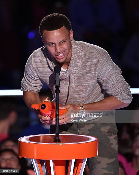 NBA player Stephen Curry accepts the Clutch Player of the Year award onstage at the Nickelodeon Kids' Choice Sports Awards 2015 at UCLA's Pauley...