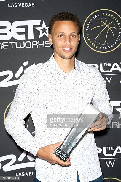 NBA player Stephen Curry of Golden State Warriors poses with his Clutch Performer Award at The Players' Awards presented by BET at the Rio Hotel...