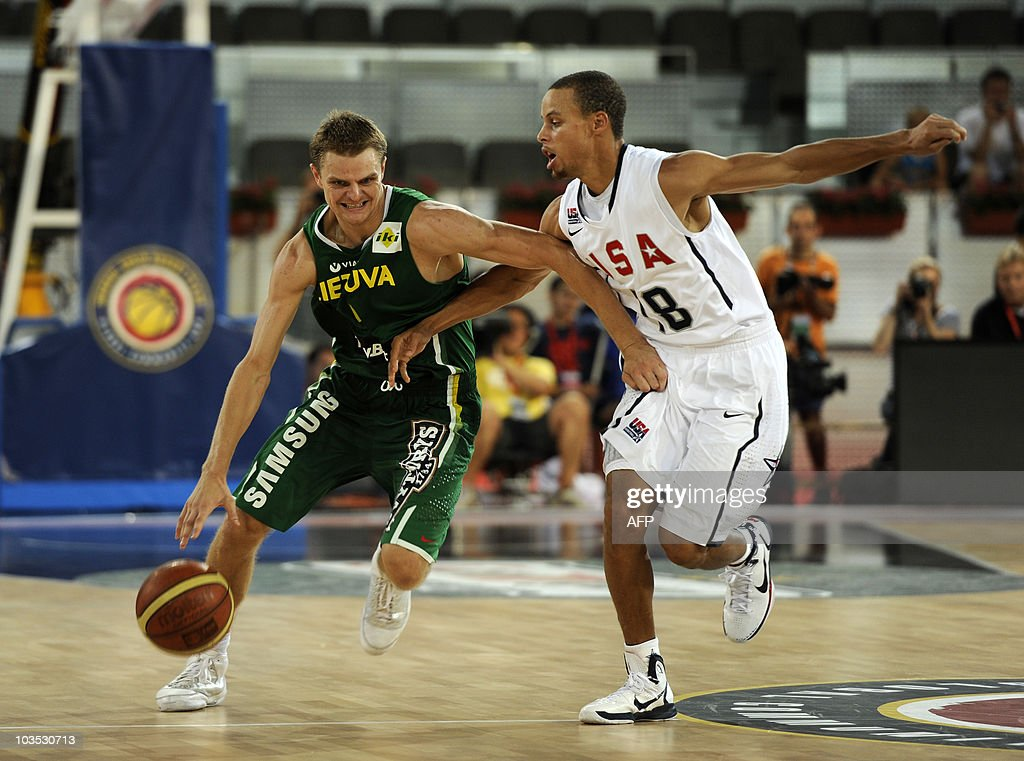US player Stephen Curry vies with lithuania's Renaldas Seibutis (L) during their friendly basketball game at the La Caja Magica pavillion in Madrid, on August 21, 2010. AFP PHOTO / Dani POZO