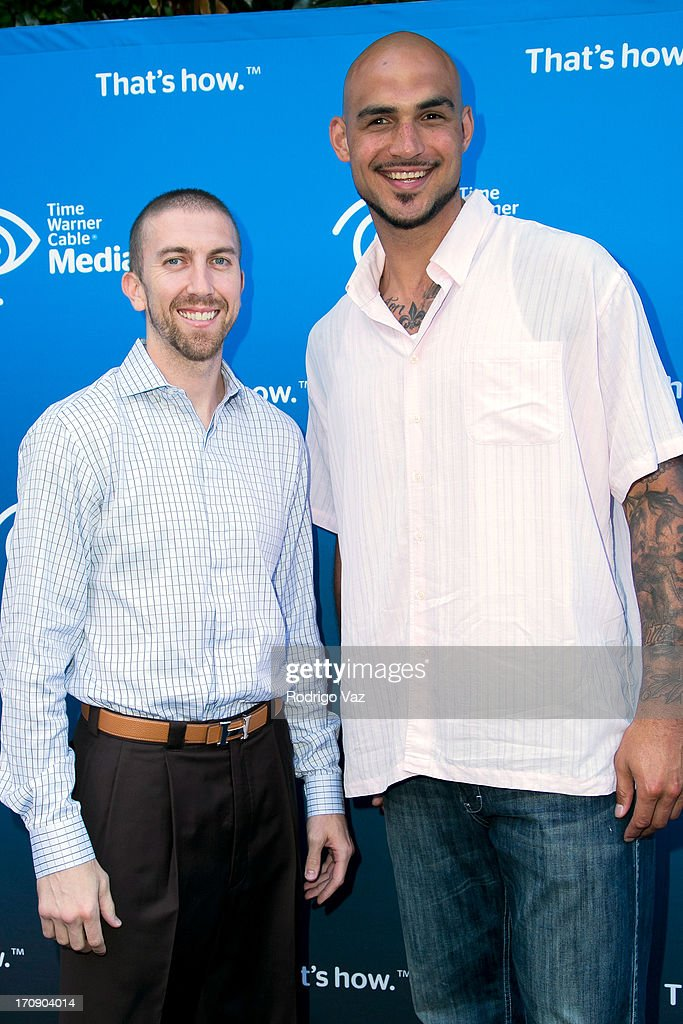 NBA player Steve Blake (L) and LA Lakers player Robert Sacre attend the Time Warner Cable Media (TWC Media) 'View From The Top' Upfront at Vibiana on June 19, 2013 in Los Angeles, California.