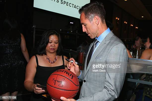 NBA player Steve Nash signs a basketball at the 2014 Sports Spectacular Gala at the Hyatt Regency Century Plaza on May 18 2014 in Century City...