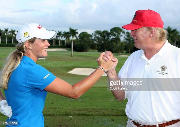 LPGA player Suzann Pettersen of Norway is greeted by Donald Trump prior to the start of the ADT Championship at the Trump International Golf Club on...
