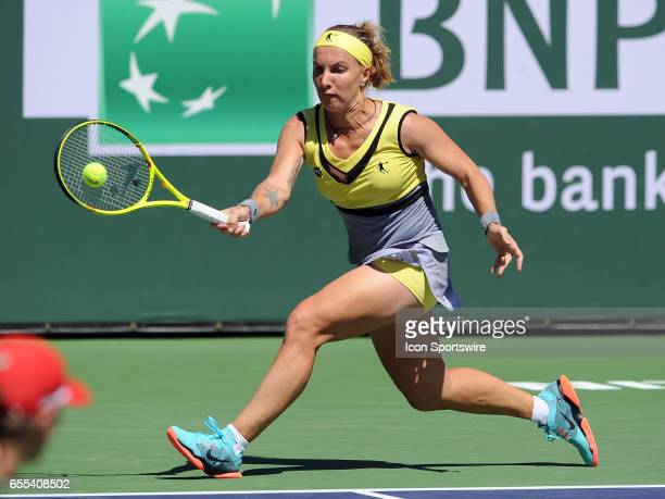WTA player Svetlana Kuznetsova returns a shot during a finals match against Elena Vesnina on March 19 during the BNP Paribas Open played at the...