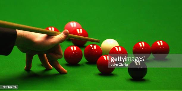 A player takes a difficult shot during the Quarter finals of the Betfred World Snooker Championships at the Crucible Theatre on April 28 2009 in...