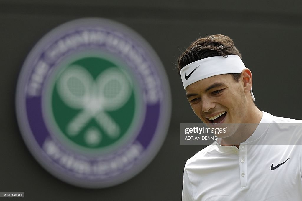 US player Taylor Fritz reacts after a point against Switzerland's Stan Wawrinka during their men's singles first round match on the second day of the 2016 Wimbledon Championships at The All England Lawn Tennis Club in Wimbledon, southwest London, on June 28, 2016. / AFP / ADRIAN