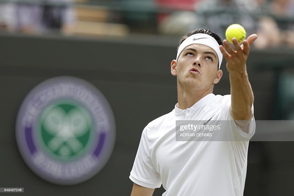 US player Taylor Fritz serves against Switzerland's Stan Wawrinka during their men's singles first round match on the second day of the 2016 Wimbledon Championships at The All England Lawn Tennis Club in Wimbledon, southwest London, on June 28, 2016. / AFP / ADRIAN