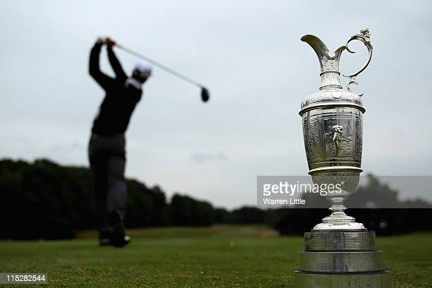 A player tees off as the Claret Jug is displayed during The Open Championship Europe International Final Qualifying at Sunningdale Golf Club on June...
