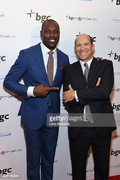 Player Terrell Owens and Chairman and CEO of Cantor Fitzgerald Howard Lutnick attends Annual Charity Day hosted by Cantor Fitzgerald BGC and GFI at...