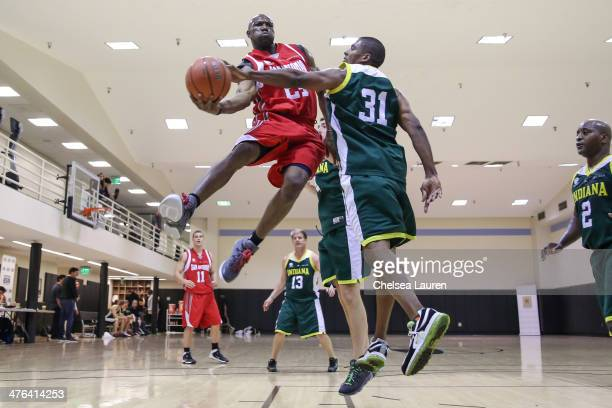 NFL player Terrell Owens and producer Val Hill attend the ELeague celebrity basketball game at Equinox Sports Club West LA on March 2 2014 in Los...
