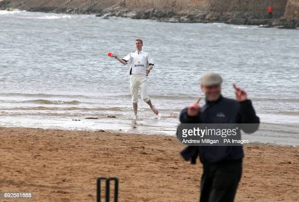 A player throws the ball during the beach cricket match in Elie between the Ship Inn cricket team in Elie Fife and Eccentric Flamingos CC as the tide...