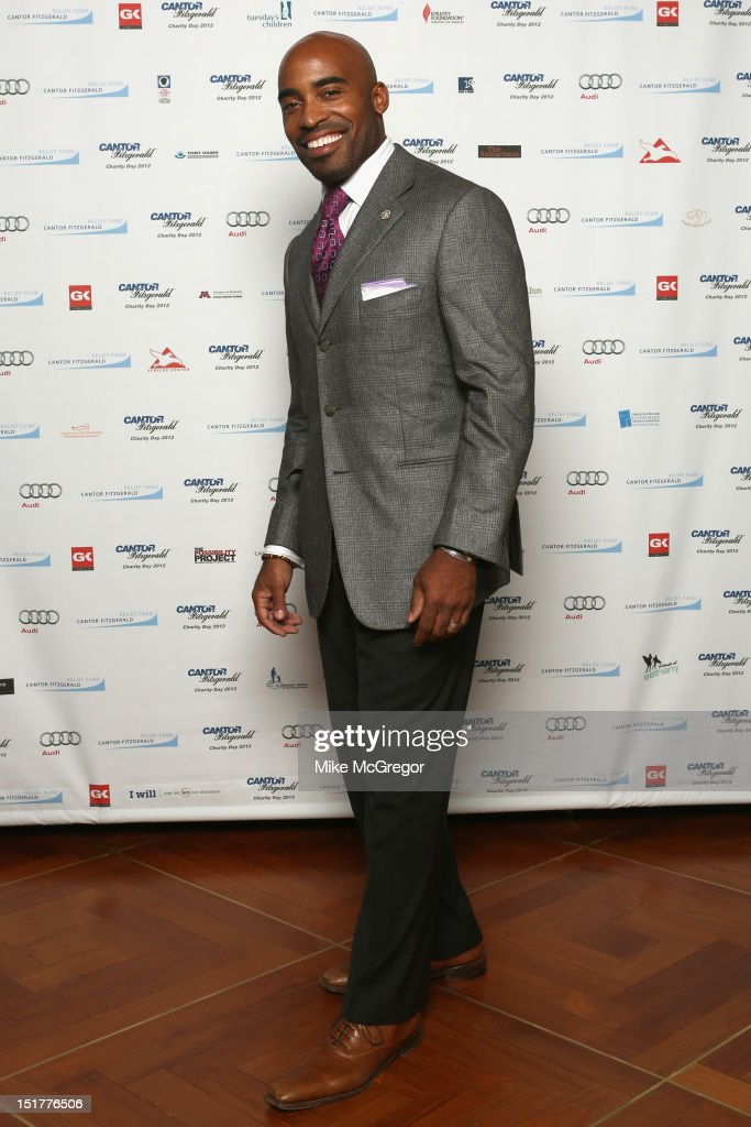 NFL player <a gi-track='captionPersonalityLinkClicked' href=/galleries/search?phrase=Tiki+Barber&family=editorial&specificpeople=184538 ng-click='$event.stopPropagation()'>Tiki Barber</a> attends Cantor Fitzgerald & BGC Partners host annual charity day on 9/11 to benefit over 100 charities worldwide at Cantor Fitzgerald on September 11, 2012 in New York City.