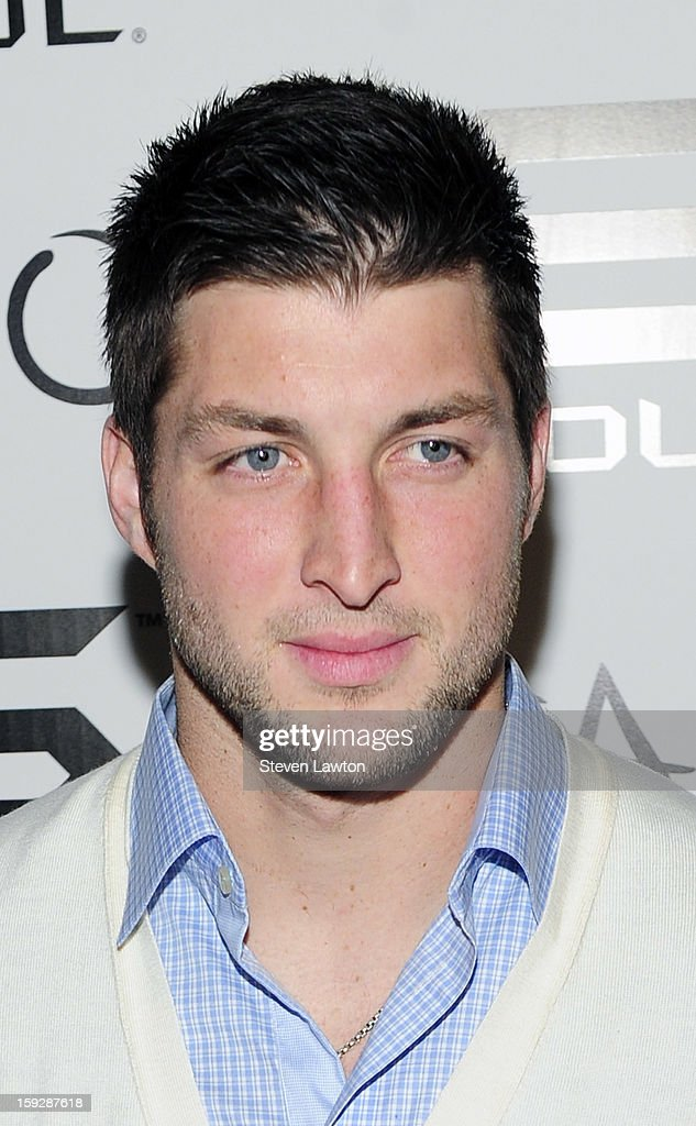NFL player <a gi-track='captionPersonalityLinkClicked' href=/galleries/search?phrase=Tim+Tebow&family=editorial&specificpeople=2729658 ng-click='$event.stopPropagation()'>Tim Tebow</a> arrives for the official Soul headphones party at Tao Nightclub at The Venetian on January 10, 2013 in Las Vegas, Nevada.