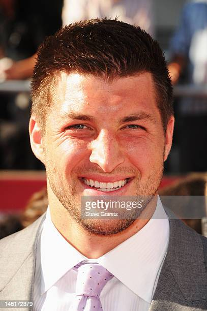 NFL player Tim Tebow of the New York Jets arrives at the 2012 ESPY Awards at Nokia Theatre LA Live on July 11 2012 in Los Angeles California