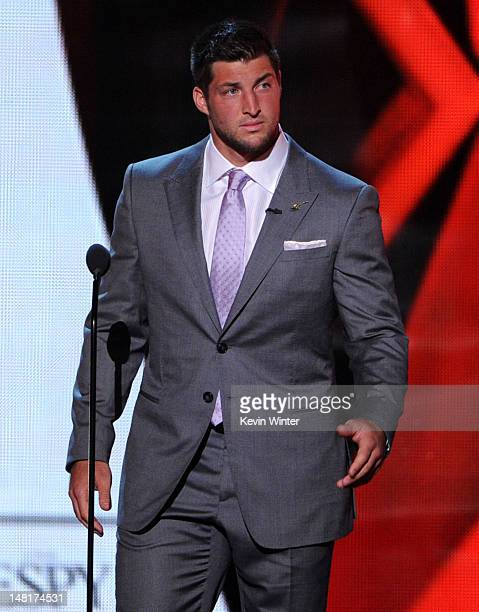 NFL player Tim Tebow of the New York Jets speaks onstage during the 2012 ESPY Awards at Nokia Theatre LA Live on July 11 2012 in Los Angeles...