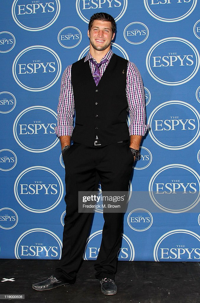 NFL player Tim Tebow poses in the press room at The 2011 ESPY Awards at Nokia Theatre L.A. Live on July 13, 2011 in Los Angeles, California.