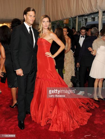 NFL player Tom Brady and model Gisele Bundchen attend the 'Alexander McQueen Savage Beauty' Costume Institute Gala at The Metropolitan Museum of Art...