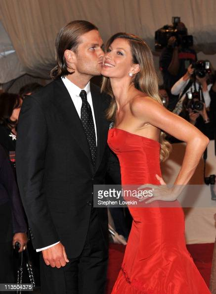 NFL player Tom Brady of the New England Patriots and model Gisele Bundchen attend the 'Alexander McQueen Savage Beauty' Costume Institute Gala at The...
