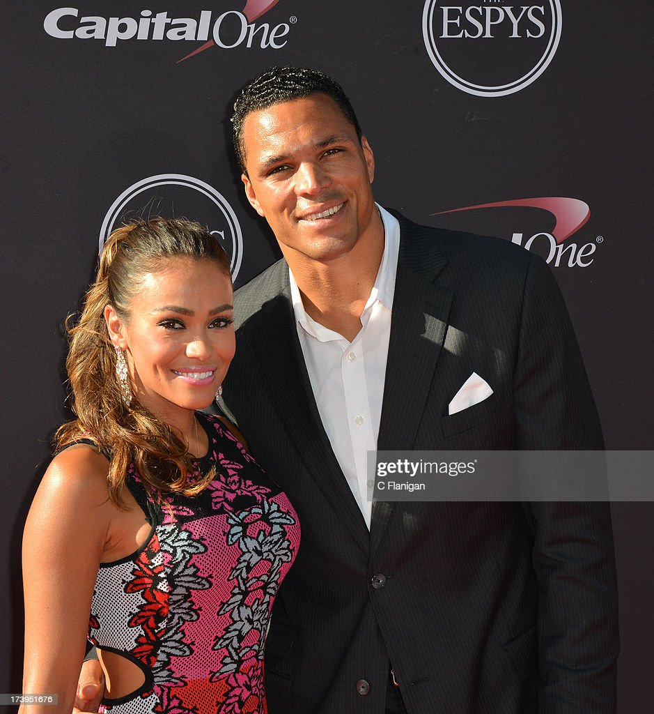NFL player Tony Gonzalez and wife October Gonzalez arrive at the 2013 ESPY Awards at Nokia Theatre L.A. Live on July 17, 2013 in Los Angeles, California.