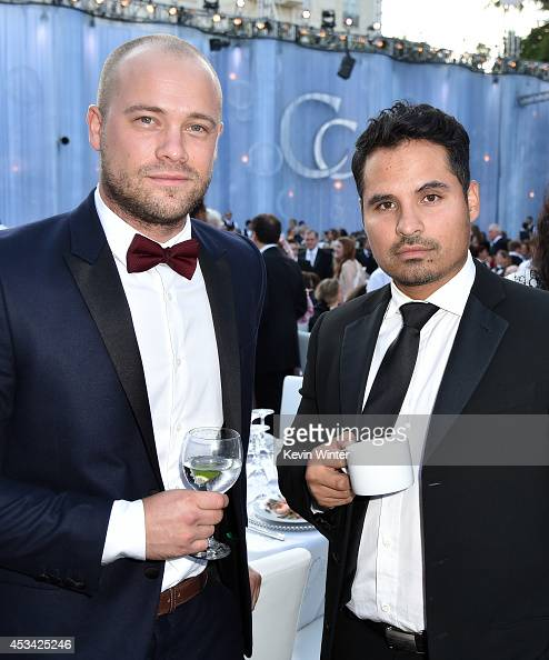 MLB player Trevor Bell and actor Michael Pena attend the Church of Scientology Celebrity Centre 45th Anniversary Gala on August 9 2014 in Los Angeles...