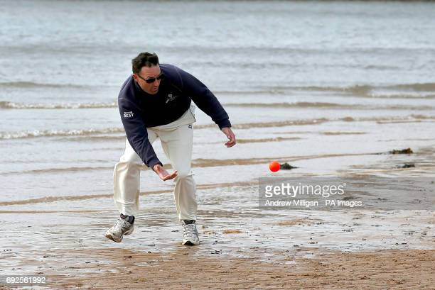 A player trys to catch ball during the beach cricket match in Elie between the Ship Inn cricket team in Elie Fife and Eccentric Flamingos CC as the...