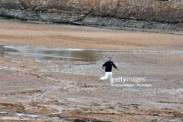 A player trys to catch the ball during the beach cricket match in Elie between the Ship Inn cricket team in Elie Fife and Eccentric Flamingos CC as...