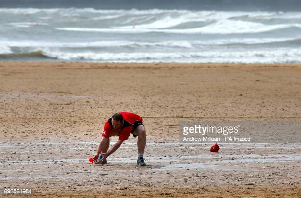 A player trys to catch the ball during the beach cricket match in Elie between the Ship Inn cricket team in Elie Fife and Eccentric Flamingos CC The...