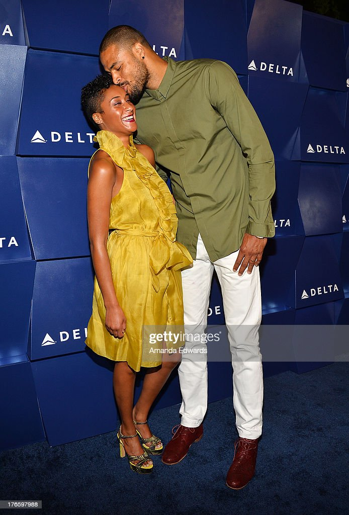 NBA player Tyson Chandler (R) and his wife Kimberly Chandler arrive at the Delta Air Lines Summer Celebration at Beverly Grove Drive on August 15, 2013 in Beverly Hills, California.