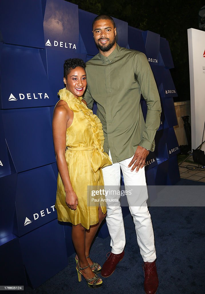 Player <a gi-track='captionPersonalityLinkClicked' href=/galleries/search?phrase=Tyson+Chandler&family=editorial&specificpeople=202061 ng-click='$event.stopPropagation()'>Tyson Chandler</a> (R) attends the Delta Air Lines summer celebration In Beverly Hills on August 15, 2013 in Beverly Hills, California.