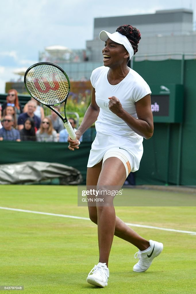 US player Venus Williams celebrates after winning a point against Greece's Maria Sakkari during their women's singles second round match on the fourth day of the 2016 Wimbledon Championships at The All England Lawn Tennis Club in Wimbledon, southwest London, on June 30, 2016. / AFP / GLYN