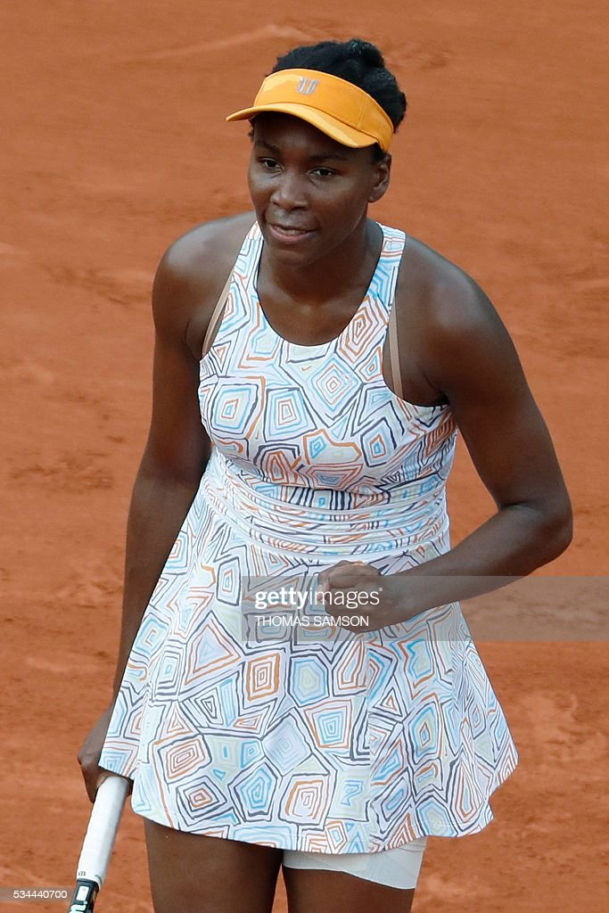 US player Venus Williams celebrates after winning a point against US player Louisa Chirico during their women's second round match at the Roland Garros 2016 French Tennis Open in Paris on May 26, 2016. / AFP / Thomas SAMSON