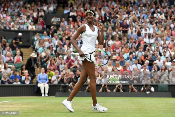 US player Venus Williams celebrates beating Latvia's Jelena Ostapenko during their women's singles quarterfinal match on the eighth day of the 2017...