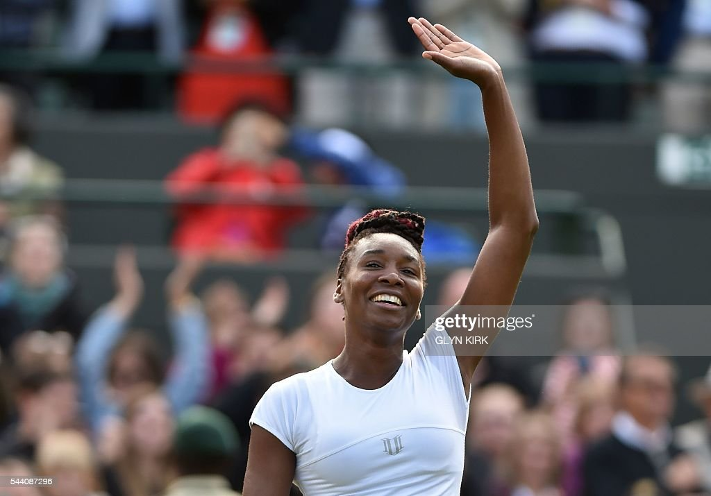 US player Venus Williams celebrates beating Russia's Daria Kasatkina during their women's singles third round match on the fifth day of the 2016 Wimbledon Championships at The All England Lawn Tennis Club in Wimbledon, southwest London, on July 1, 2016. / AFP / GLYN