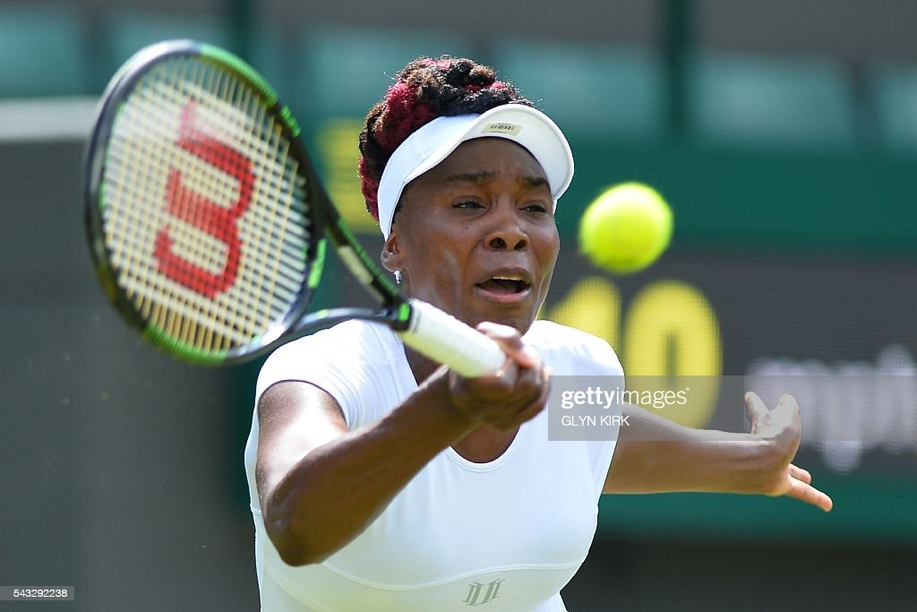 US player Venus Williams returns against Croatia's Donna Vekic during their women's singles first round match on the first day of the 2016 Wimbledon Championships at The All England Lawn Tennis Club in Wimbledon, southwest London, on June 27, 2016. / AFP / GLYN