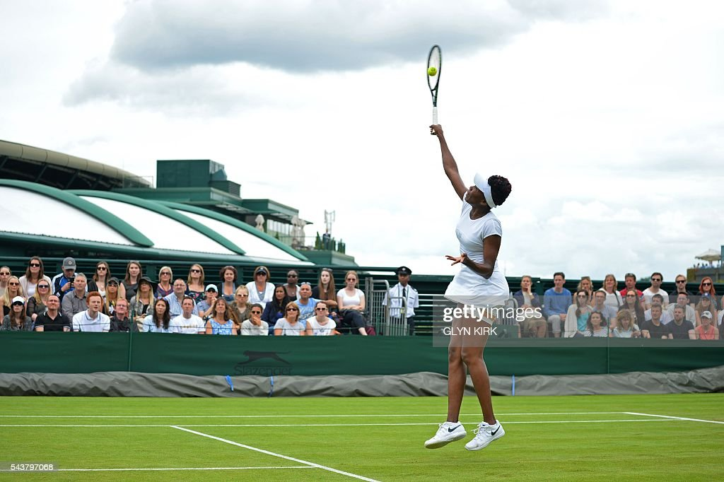 US player Venus Williams returns against Greece's Maria Sakkari during their women's singles second round match on the fourth day of the 2016 Wimbledon Championships at The All England Lawn Tennis Club in Wimbledon, southwest London, on June 30, 2016. / AFP / GLYN