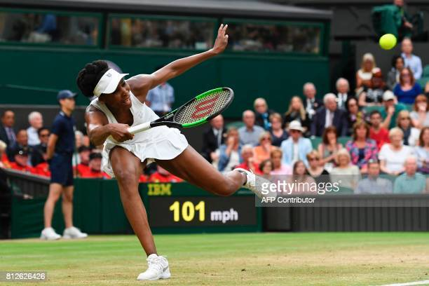 TOPSHOT US player Venus Williams returns against Latvia's Jelena Ostapenko during their women's singles quarterfinal match on the eighth day of the...
