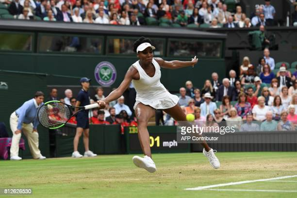 US player Venus Williams returns against Latvia's Jelena Ostapenko during their women's singles quarterfinal match on the eighth day of the 2017...