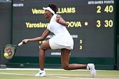 CORRECTION US player Venus Williams returns to Kazakhstan's Yaroslava Shvedova during their women's singles quarterfinal match on the ninth day of...