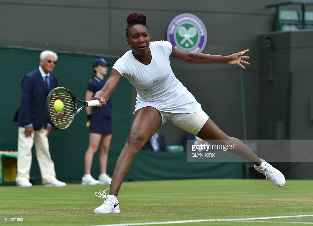 US player Venus Williams returns to Russia's Daria Kasatkina during their women's singles third round match on the fifth day of the 2016 Wimbledon Championships at The All England Lawn Tennis Club in Wimbledon, southwest London, on July 1, 2016. / AFP / GLYN