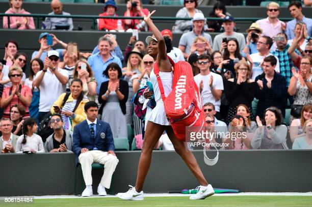US player Venus Williams waves as she leaves the court after beating Belgium's Elise Mertens during their women's singles first round match on the...
