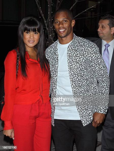 Player Victor Cruz and guest attend The Cinema Society and Men's Fitness screening of 'Pain and Gain' at Crosby Street Hotel on April 15 2013 in New...