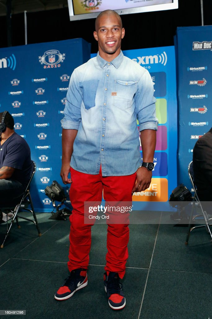 Player <a gi-track='captionPersonalityLinkClicked' href=/galleries/search?phrase=Victor+Cruz+-+Football+americano&family=editorial&specificpeople=8736842 ng-click='$event.stopPropagation()'>Victor Cruz</a> attends SiriusXM's Live Broadcast from Radio Row during Bowl XLVII week on February 1, 2013 in New Orleans, Louisiana.