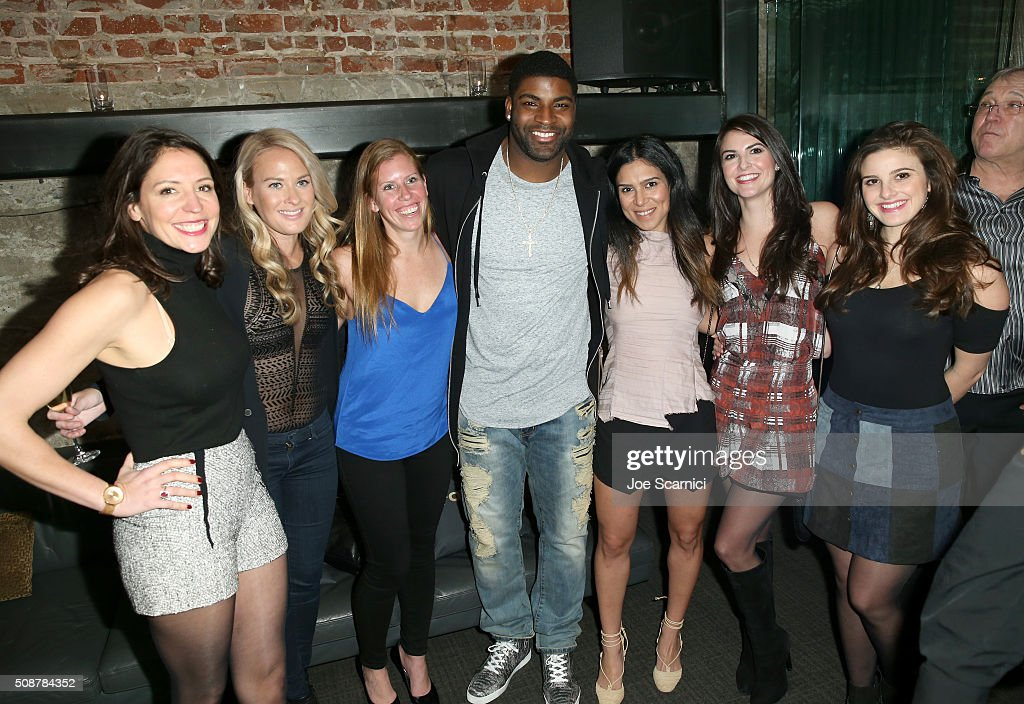 NFL player <a gi-track='captionPersonalityLinkClicked' href=/galleries/search?phrase=Vinny+Curry&family=editorial&specificpeople=5523692 ng-click='$event.stopPropagation()'>Vinny Curry</a> (C) and guests attend Fanatics Super Bowl Party on February 6, 2016 in San Francisco, California.