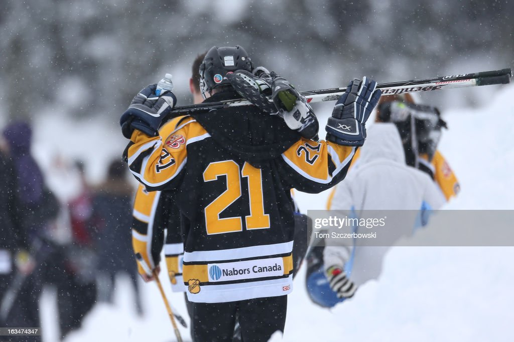 A player walks off after his outdoor shinny hockey game at the 4th Annual Lake Louise Pond Hockey Classic on the frozen surface of Lake Louise on March 2, 2013 in Lake Louise, Alberta, Canada.