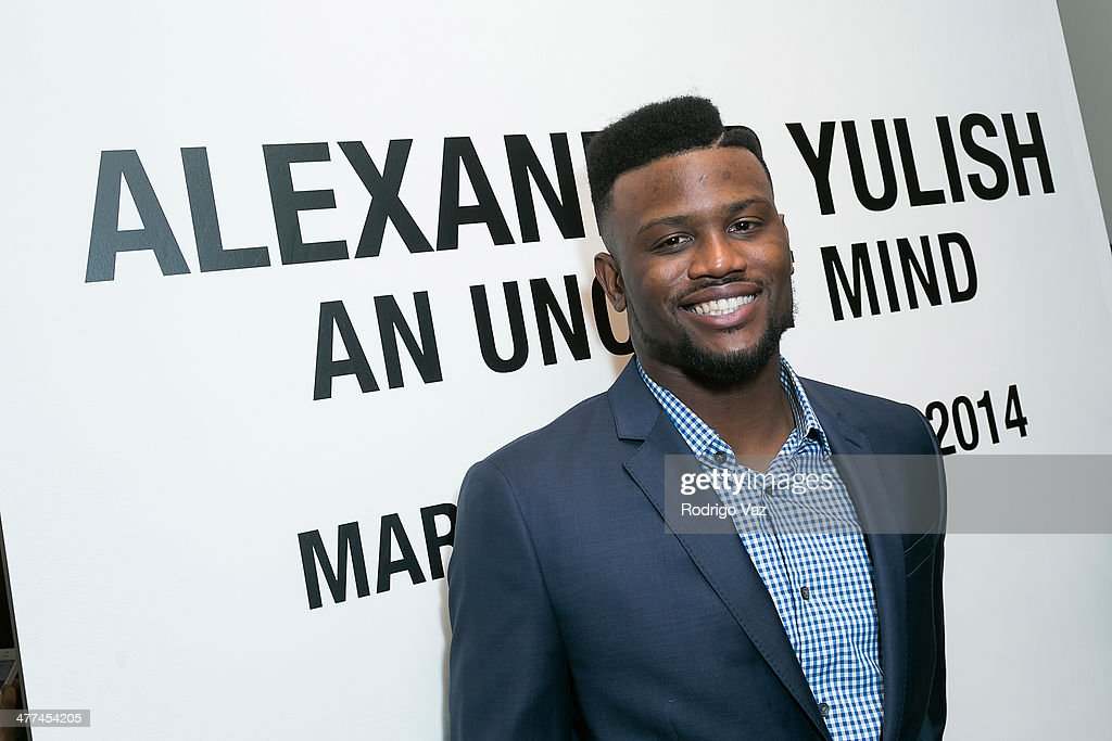 NFL player <a gi-track='captionPersonalityLinkClicked' href=/galleries/search?phrase=Walter+Thurmond&family=editorial&specificpeople=3958038 ng-click='$event.stopPropagation()'>Walter Thurmond</a> attends Alexander Yulish 'An Unquiet Mind' VIP Opening Reception at KM Fine Arts LA Studio on March 8, 2014 in Los Angeles, California.