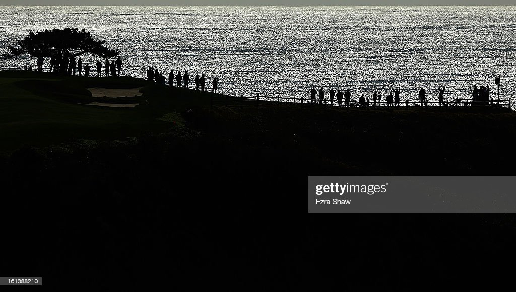 A player watches his tee shot on the seventh hole during the final round of the AT&T Pebble Beach National Pro-Am at Pebble Beach Golf Links on February 10, 2013 in Pebble Beach, California.
