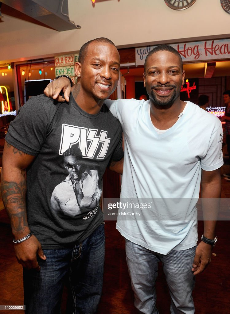 NFL player <a gi-track='captionPersonalityLinkClicked' href=/galleries/search?phrase=Willis+McGahee&family=editorial&specificpeople=202895 ng-click='$event.stopPropagation()'>Willis McGahee</a> of the Baltimore Ravens and <a gi-track='captionPersonalityLinkClicked' href=/galleries/search?phrase=DJ+Irie&family=editorial&specificpeople=558947 ng-click='$event.stopPropagation()'>DJ Irie</a> attend the grand opening of Brother Jimmy's BBQ on March 12, 2011 in St Maarten, Netherlands Antilles.